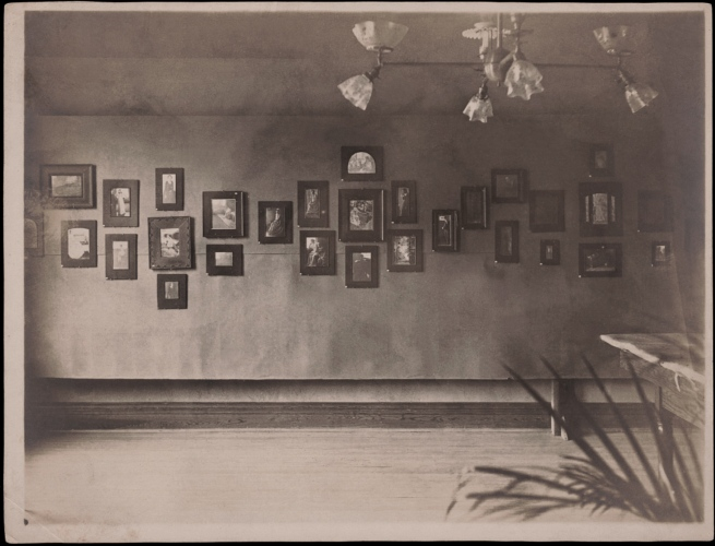 Display of Clarence H. White photographs in Newark Camera Club exhibition, Young Men's Christian Association building, Newark, Ohio, 1899