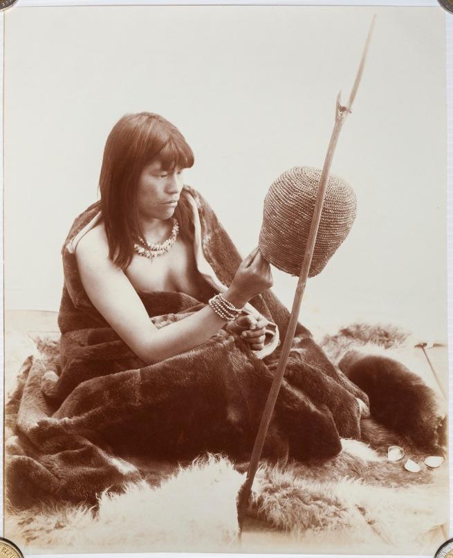 Sociedad Fotográfica Argentina de Aficionados (Argentine, active 1889-1926) 'India yagán u ona tejiendo una canasta' / 'Yagán or Ona Woman Weaving a Basket' c. 1890s