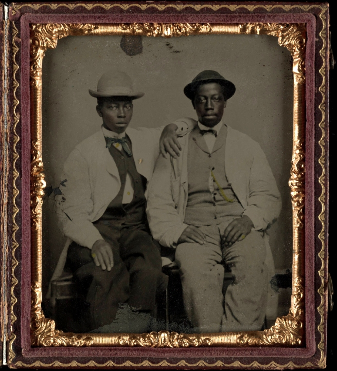 Unknown photographer (American) 'Untitled [Two young men with straw hats, seated beside each other]' Nd