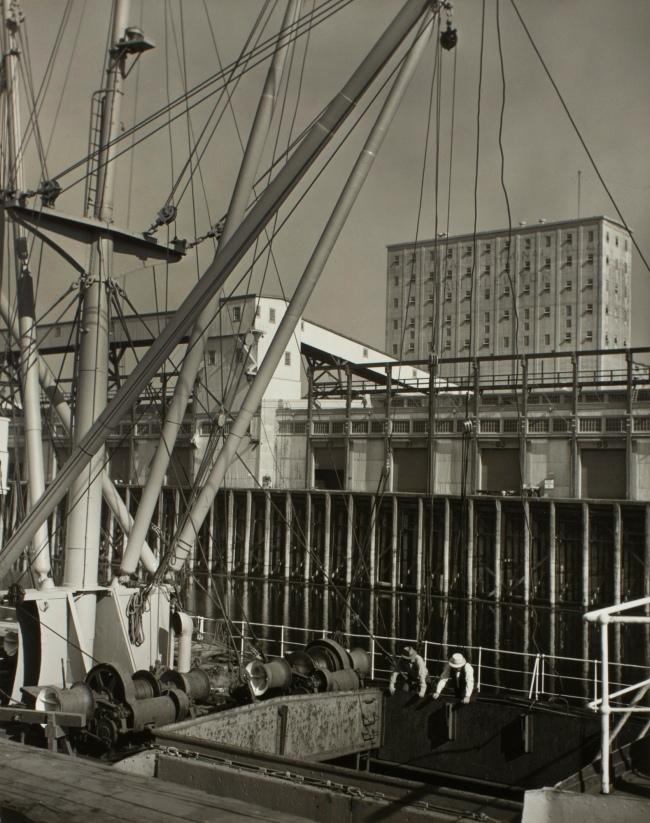 Minor White(American, 1908-1976) 'Untitled (Ship and Grain Elevator)' c. 1939