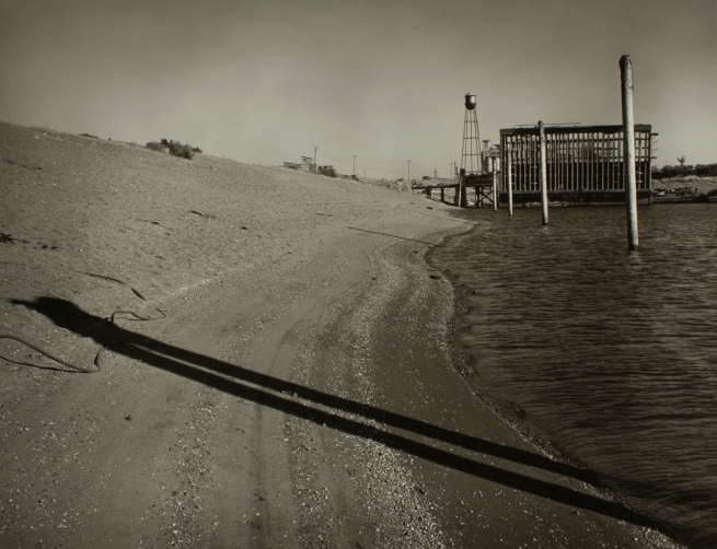 Minor White(American, 1908-1976) 'Untitled (Beach and Pilings)' c. 1939