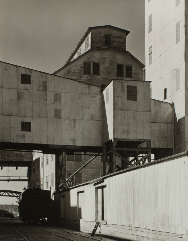 Minor White(American, 1908-1976) 'Grain Loading Depot' 1939