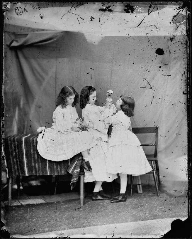 Lewis Carroll (1832-98) ''Open your mouth, and shut your eyes' (Edith Mary Liddell; Ina Liddell; Alice Liddell)' July 1860