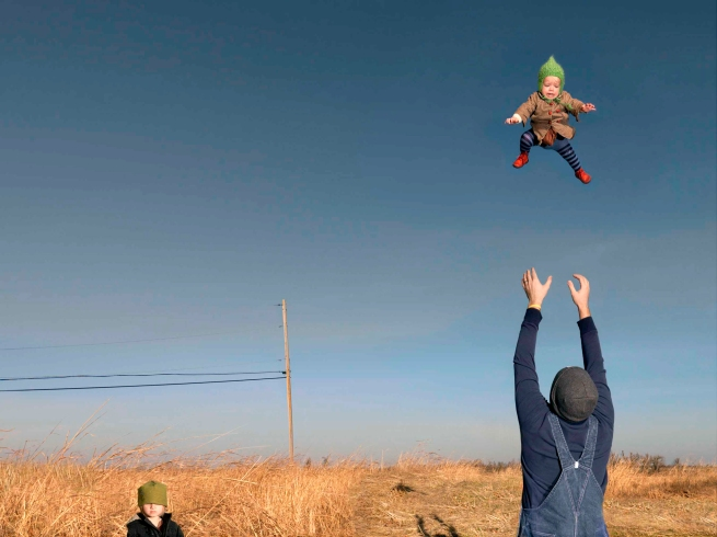 Julie Blackmon (American, born in 1966) 'Baby Toss' 2009
