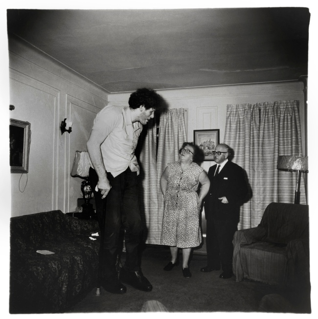 Diane Arbus (1923-71) 'A Jewish giant at home with his parents in the Bronx, N.Y., 1970' 1970