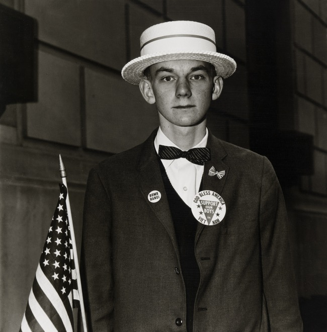 Diane Arbus (1923-71) 'Boy with a straw hat waiting to march in a pro-war parade, N.Y.C., 1967' 1967