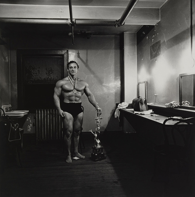 Diane Arbus (1923-71) 'Muscle Man in his dressing room with trophy, Brooklyn, N.Y.' 1962