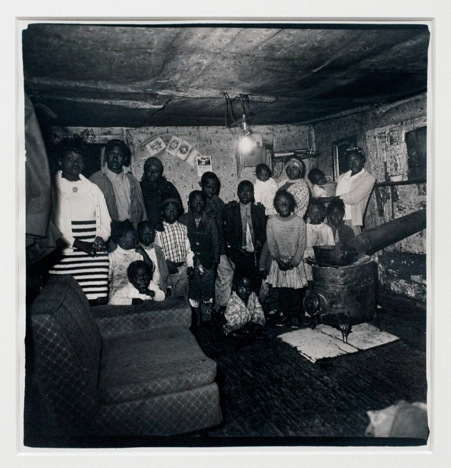Diane Arbus (1923-71) 'Large black family in small shack [Robert Evans and his family, 1968]' 1968 (installation view)