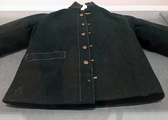 Installation view of the exhibition Colony: Australia 1770 - 1861 at NGV Australia at Federation Square, Melbourne showing Unknown, Tasmania 'Jacket' mid 19th century