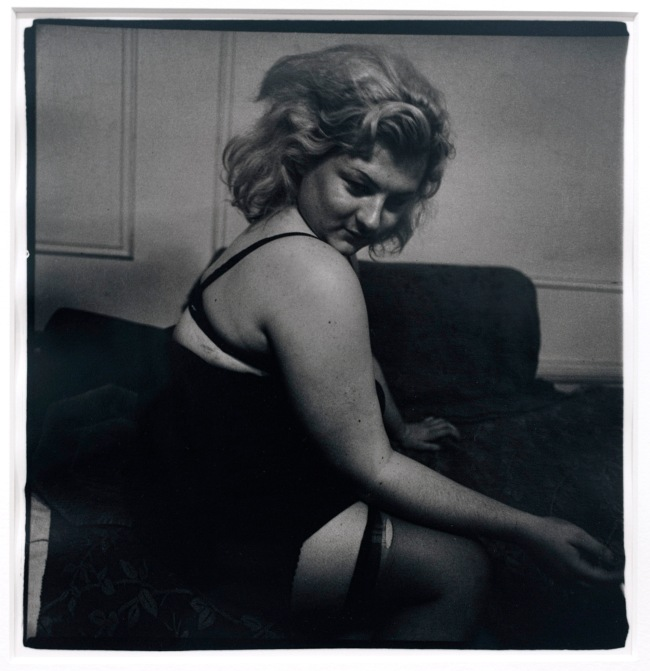 Diane Arbus (1923-71) 'Transvestite with torn stocking, N.Y.C. 1966' 1966 (installation view)