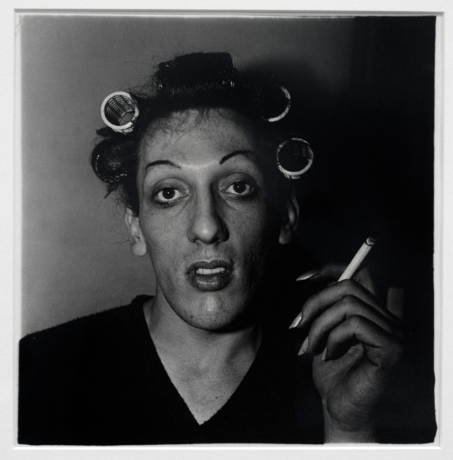 Diane Arbus (1923-71) 'A young man in curlers at home on West 20th St., N.Y.C. 1966' 1966 (installation view)