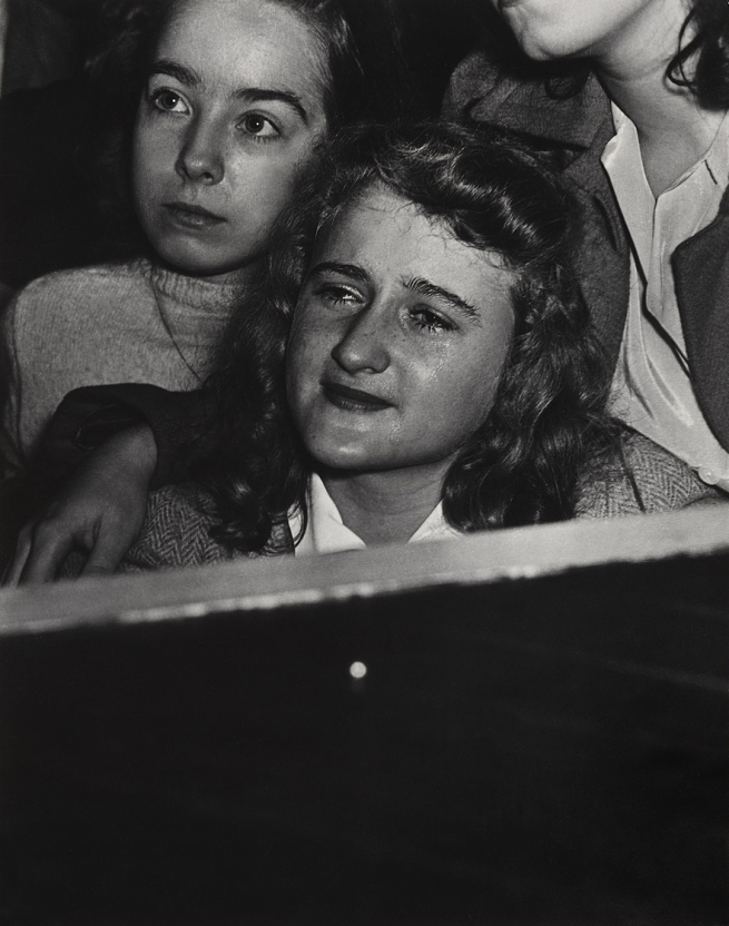 Weegee (Arthur Fellig) (1899-1968) 'No title (listening to Frank Sinatra, Palace theatre)' c. 1944