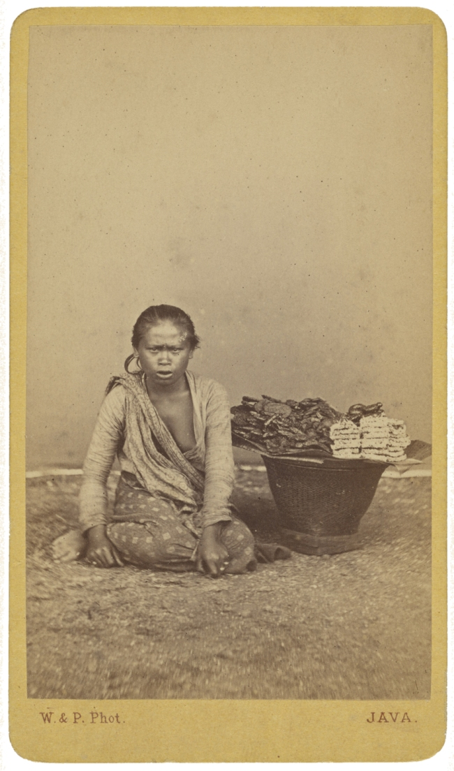 Woodbury & Page (British, active 1857-1908) '[Javanese woman seated with legs crossed, basket at side]' c. 1870
