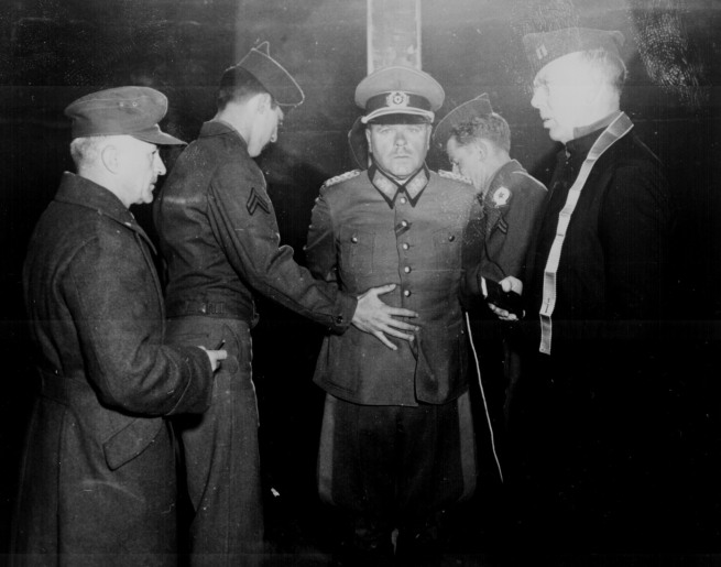 German Gen. Anton Dostler is tied to a stake before his execution