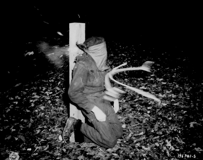 Unknown photographer. 'Photo taken at the instant bullets from a French firing squad hit a Frenchman who collaborated with the Germans. This execution took place in Rennes, France. 21 November 1944'