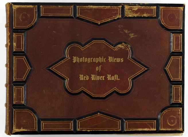 Cover the photographic album 'Photographic Views of Red River Raft' 1873