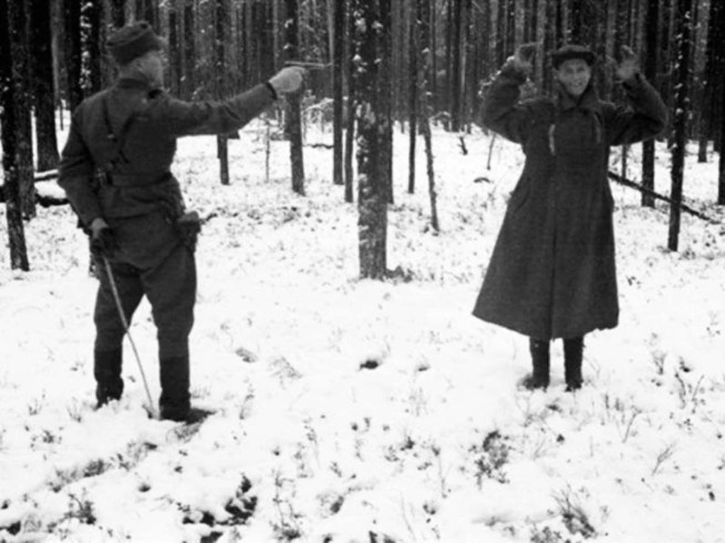 Anonymous photographer. 'Russian spy laughing through his execution in Finland, 1942' 1942