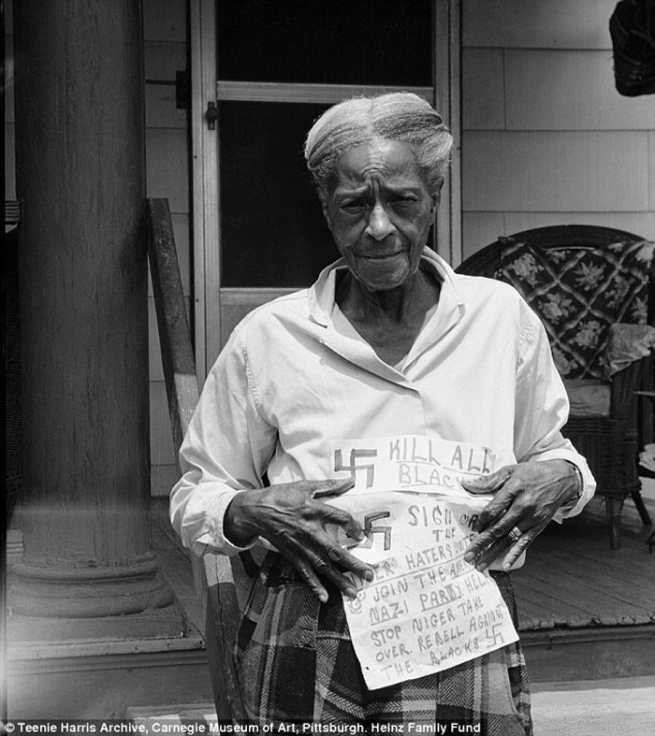 """Charles """"Teenie""""Harris (1908-1998) 'Mary Reid holding threatening notes with swastikas and American Nazi Party propaganda, in July 1964' 1964"""