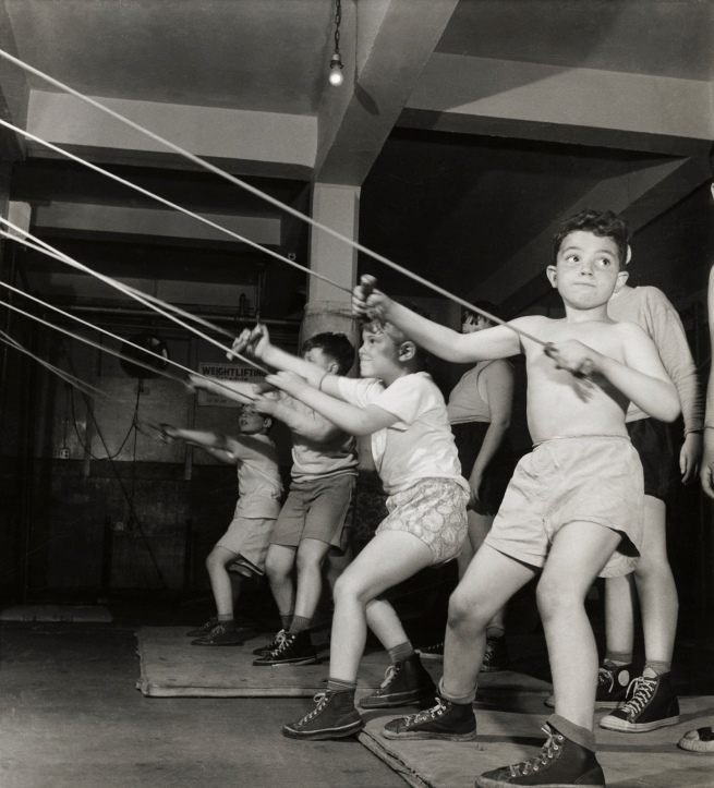 Roman Vishniac (1897-1990) 'Boys exercising in the gymnasium of the Jewish Community House of Bensonhurst, Brooklyn' 1949