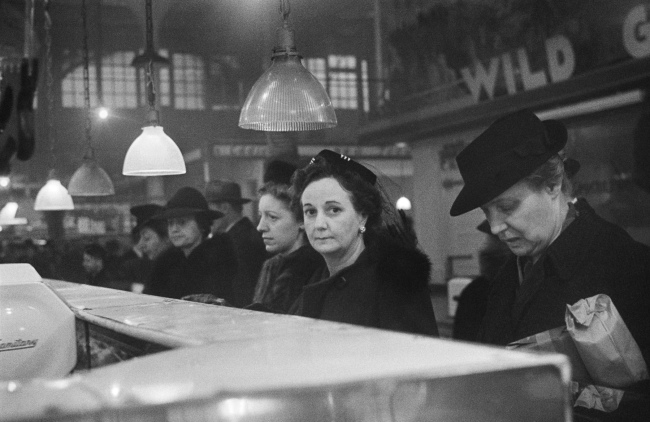 Roman Vishniac (1897-1990) 'Customers waiting in line at a butcher's counter during wartime rationing, Washington Market, New York' 1941-44
