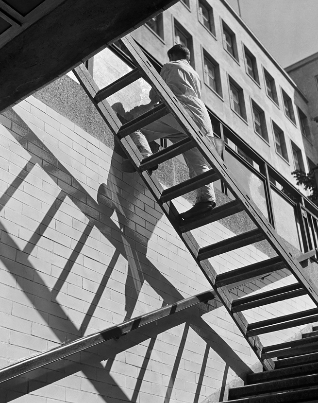 Roman Vishniac (1897-1990) 'Window washer balancing on a ladder, Berlin' mid-1930s