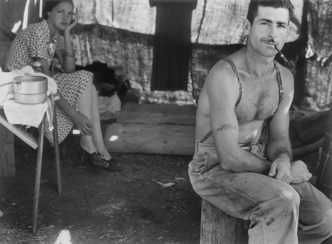 Dorothea Lange (1895-1966) 'Unemployed lumber worker goes with his wife to the bean harvest. Note social security number tattooed on his arm, Oregon' 1939