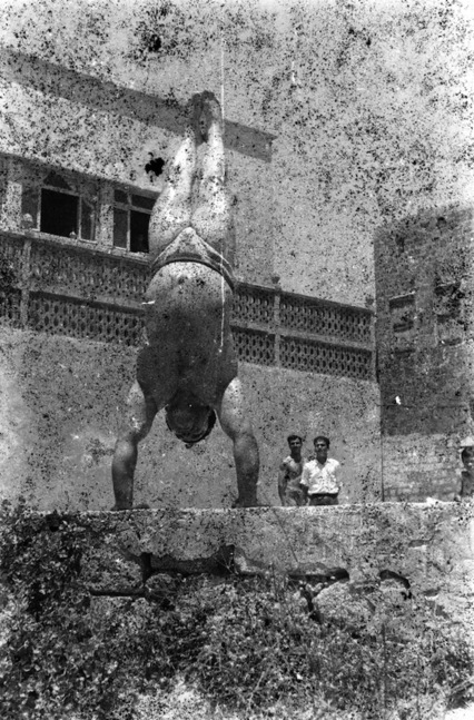 Akram Zaatari. 'Bodybuilders Printed From A Damaged Negative' 2011