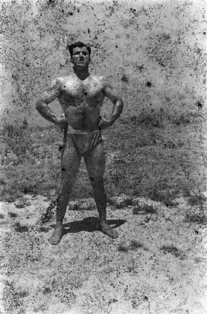 Akram Zaatari. 'Bodybuilders Printed From A Damaged Negative' 2011
