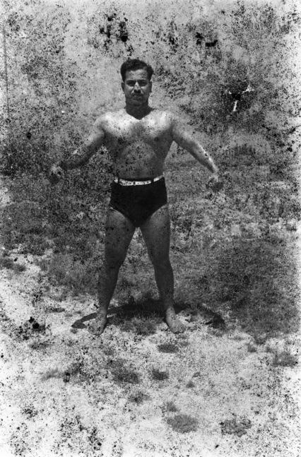 Akram Zaatari. 'Bodybuilders, Printed From A Damaged Negative Showing Hassan El Aakkad In Saida, 1948' 2007