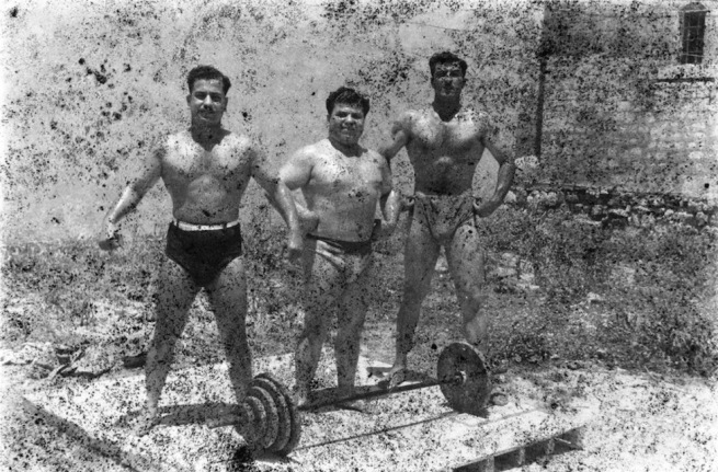 Akram Zaatari. 'Bodybuilders, Printed From A Damaged Negative Showing From Left To Right: Hassan El Aakkad, Munir El Dada And Mahmoud El Dimassy In Saida, 1948' 2011