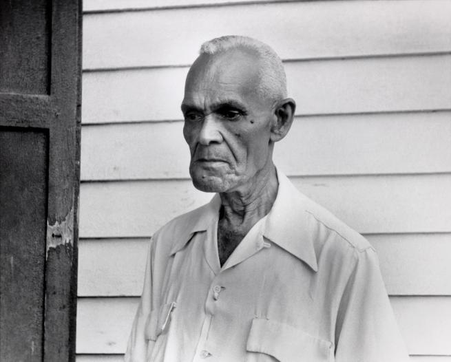 "Ralston Crawford (American 1906-1978) 'John ""Papa"" Joseph, Outside Barbershop, New Orleans' 1958"