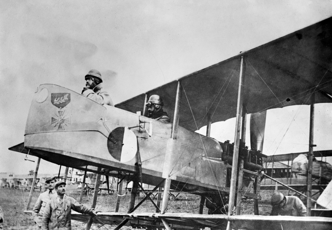 Captain Maurice Happe, rear seat, commander of French squadron MF 29, seated in his Farman MF.11 Shorthorn bomber with a Captain Berthaut