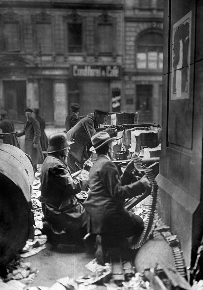Willy Römer (German, 1887-1979) 'Machine-gun post behind barricades consisting of rolled newspaper in front of the Mosse building on Schützenstraße' 11.1.1919