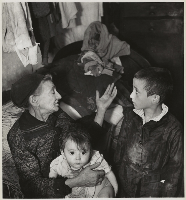 Roman Vishniac (1897-1990) '[Grandmother and grandchildren in basement dwelling, Krochmaina Street, Warsaw]' c. 1935-38