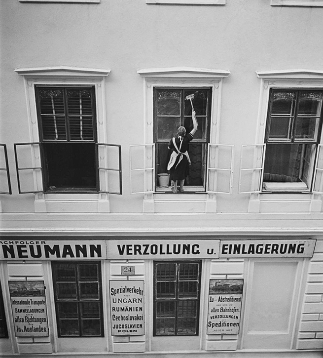 Roman Vishniac (1897-1990) 'Woman washing windows above Mandtler & Neumann Speditionen (Mandtler & Neumann Forwarding Agents), Ferdinandstrasse, Leopoldstadt, Vienna' 1930s