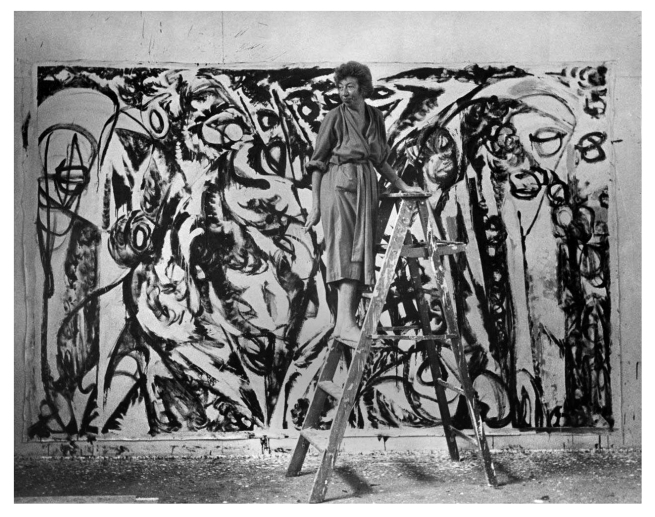 Halley Erskine. 'Lee Krasner standing on a ladder in front of 'The Gate' (1959) before it was completed, Springs, July or August 1959' 1959