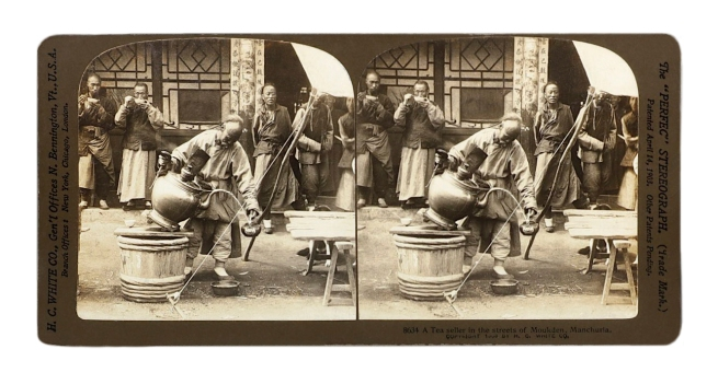 "Herbert Ponting (1870-1935) (photographer) The ""Perfec"" Stereograph. H.C. White Co., (publisher) 'A Tea seller in the streets of Moukden, Manchuria' c. 1906"