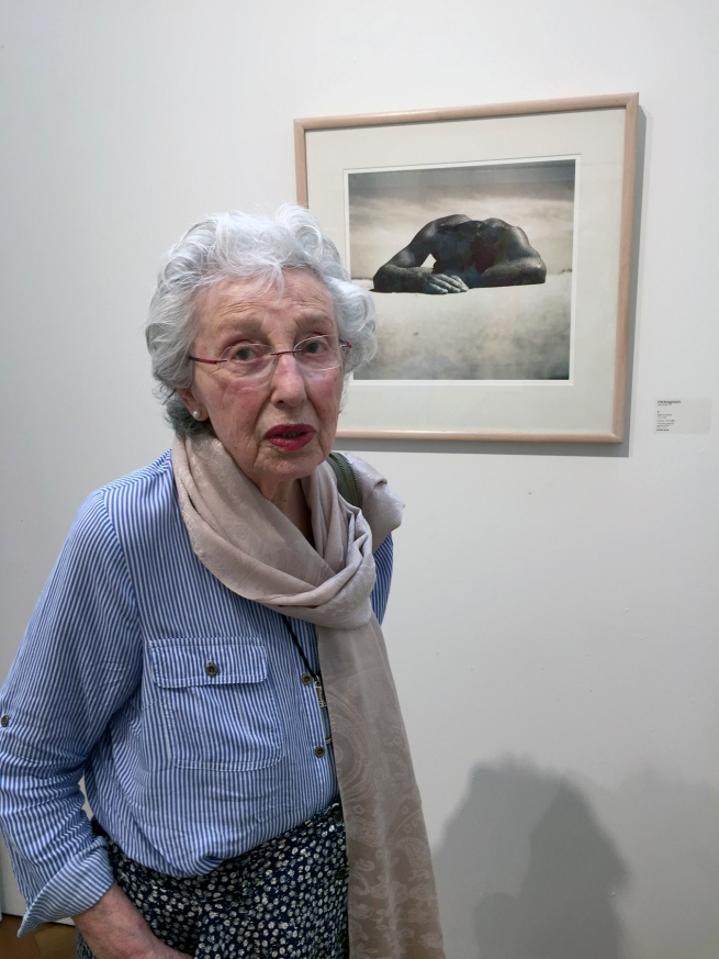 Marcus Bunyan (Australian, b. 1958) 'Joyce Evans standing in front of Max Dupain's 'Sunbaker'1937' 2018