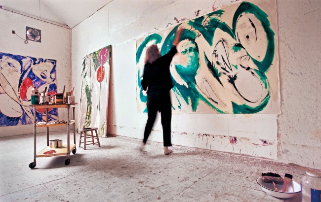 Lee Krasner, who died in 1984, at work in her studio in the 60s, painting 'Portrait in Green'