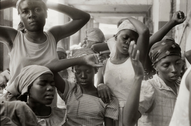 Danny Lyon (American, b. 1942) 'Haitian women praying in the market, HAITI, March 1986' 1986