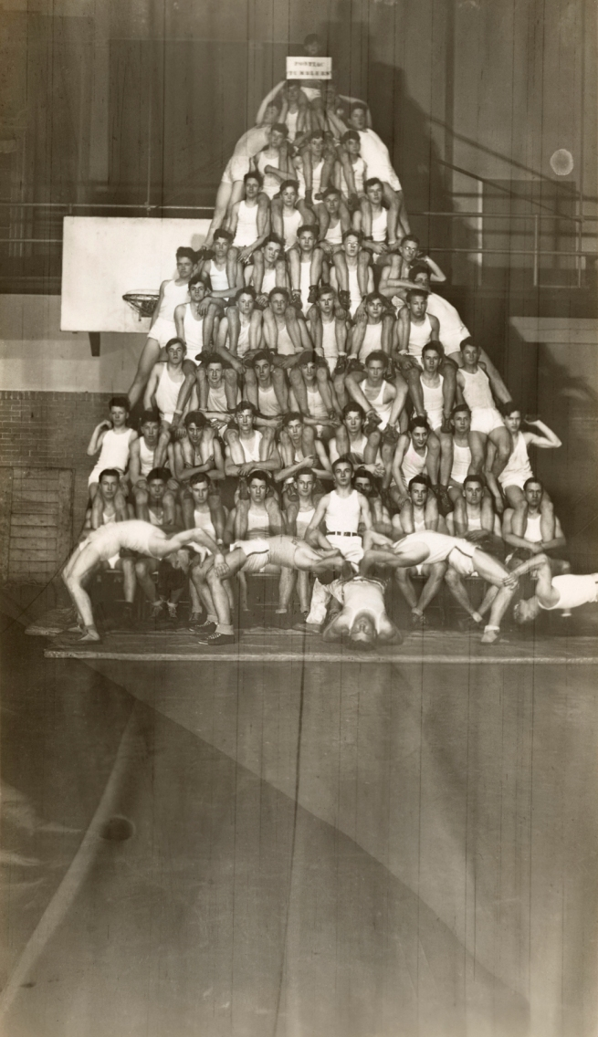 Photographer Unidentified (American) 'Untitled (human pyramid: fifty-six boys in white uniforms arranged in eight levels in a gymnasium)' 20th century