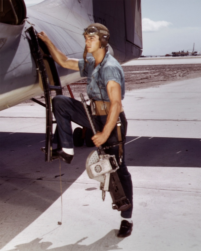 Howard R. Hollem (American, -1949) for the United States Office of War Information. 'Jesse Rhodes Waller, a World War II Aviation Ordnanceman stationed at the Naval Air Station in Corpus Christi, Texas, installing a M1919 Browning machine gun in a United States Navy PBY plane' (detail) August 1942