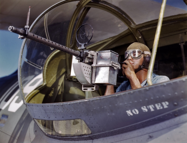 Howard R. Hollem (American, -1949) for the United States Office of War Information. 'US Navy ordnanceman Jesse Rhodes Waller posing with a M1919 Browning machine gun in a PBY Catalina aircraft, Naval Air Station, Corpus Christi, Texas, United States' August 1942