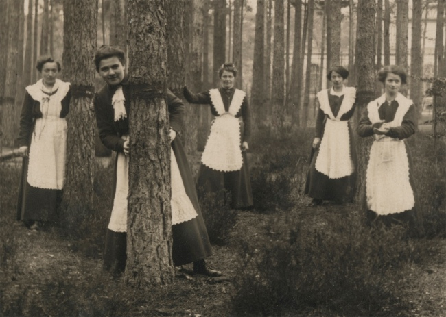 Photographer Unidentified. 'Untitled (women in aprons pose among trees)' 1913 (detail)