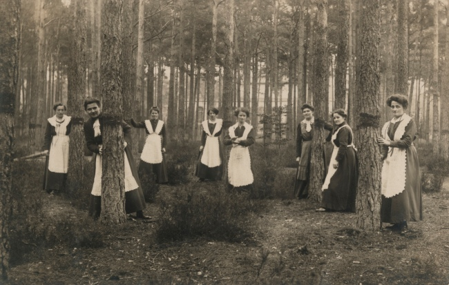 Photographer Unidentified. 'Untitled (women in aprons pose among trees)' 1913