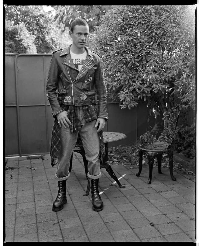 Marcus Bunyan (Australian, b. 1958) 'Self-portrait with punk jacket, flanny and 14 hole steel toe capped Docs' 1991