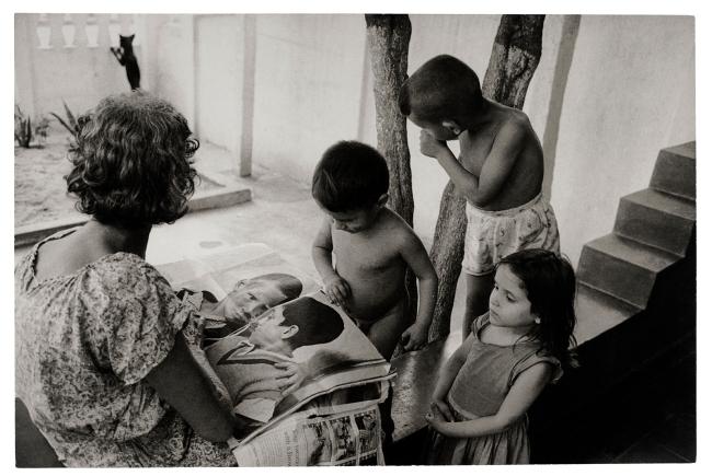 Henri Ballot (French / Brazilian, 1921-1997) 'Maria Penha da Silva, Flávio's Grandmother, and Her Other Grandchildren, Reading 'Life', Guadalupe, Rio de Janeiro, Brazil' 1961