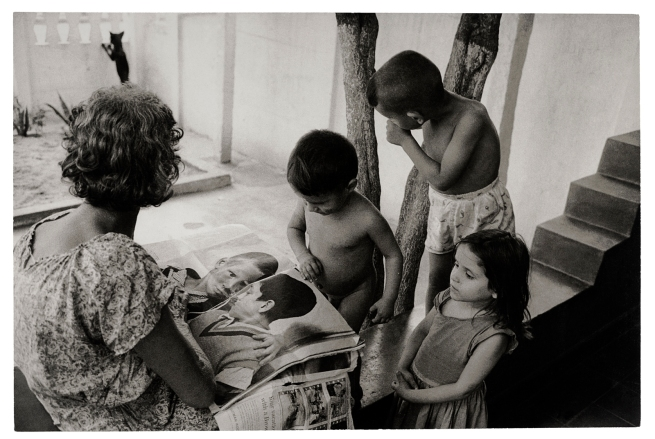 Henri Ballot (French / Brazilian, 1921-1997) 'Maria Penha da Silva, Flávio's Grandmother, and Her Other Grandchildren, Reading 'Life', Guadalupe, Rio de Janeiro, Brazil' 1961