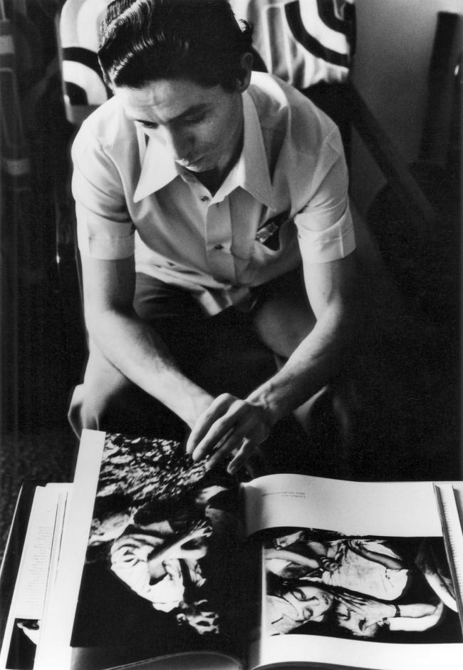 Gordon Parks (American, 1912-2006) 'Flávio da Silva Looking at Gordon Parks's Book 'Moments Without Proper Names', Rio de Janeiro, Brazil' 1976