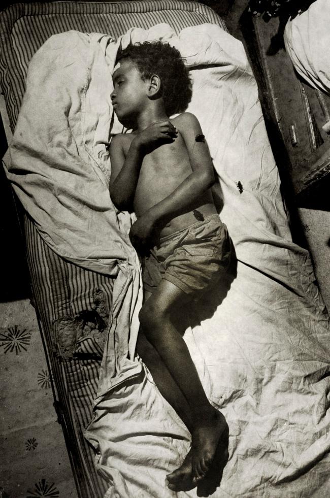 Henri Ballot (French / Brazilian, 1921-1997) 'Ely-Samuel Gonzalez on His Bed, Manhattan, New York' 1961